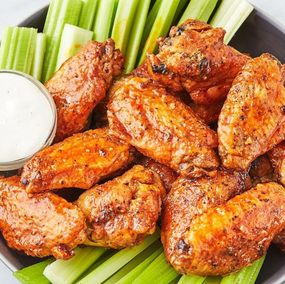 """<p><a href=""""https://www.delish.com/uk/cooking/recipes/a30975501/fried-chicken-wings-recipe/"""" rel=""""nofollow noopener"""" target=""""_blank"""" data-ylk=""""slk:Fried Chicken Wings"""" class=""""link rapid-noclick-resp"""">Fried Chicken Wings</a> are delicious, but they make a big mess. These air fryer wings are super-easy, and they're just as crunchy as the oil-fried kind. We're hooked! Add buffalo sauce (or, really, any sauce you're a fan of) and you're good to go! </p><p>Get the <a href=""""https://www.delish.com/uk/cooking/recipes/a32262330/air-fryer-chicken-wings-recipe/"""" rel=""""nofollow noopener"""" target=""""_blank"""" data-ylk=""""slk:Air Fryer Chicken Wings"""" class=""""link rapid-noclick-resp"""">Air Fryer Chicken Wings</a> recipe.</p>"""