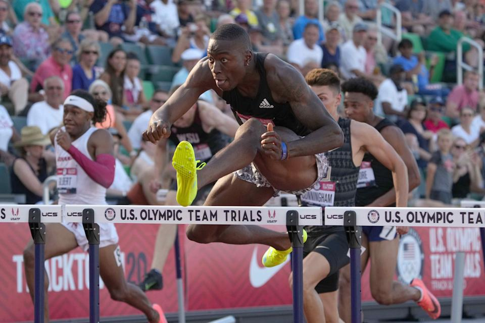 Grant Holloway set a U.S. record in the 60 meter hurdles with a time of 7.35 seconds.