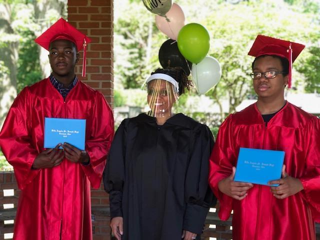 Judge Wanda C. Jones stands proudly with high school seniors Jalen McMillian (L) and Markel Glaspie (R) after officiating their graduation. (Photo: LaKishia McMillian)
