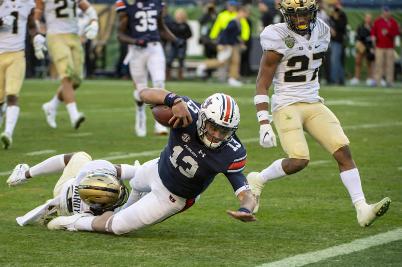 NASHVILLE, TN - DECEMBER 28: Joey Gatewood #13 of the Auburn Tigers is tackled at the goal line by Kamal Hardy #3 of the Purdue Boilermakers during the second half at Nissan Stadium on December 28, 2018 in Nashville, Tennessee. (Photo by Timothy Nwachukwu/Getty Images)