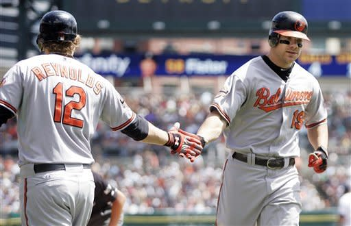 Baltimore Orioles' Chris Davis (19) is congratulated by Mark Reynolds (12) after hitting a solo home run in the second inning of a baseball game against the Detroit Tigers, Sunday, Aug. 19, 2012, in Detroit. The Orioles defeated the Tigers 7-5. (AP Photo/Duane Burleson)