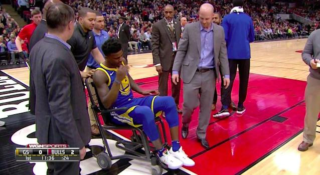 Warriors rookie Jordan Bell leaves the court at United Center in a wheelchair. (Screencap via NBA)