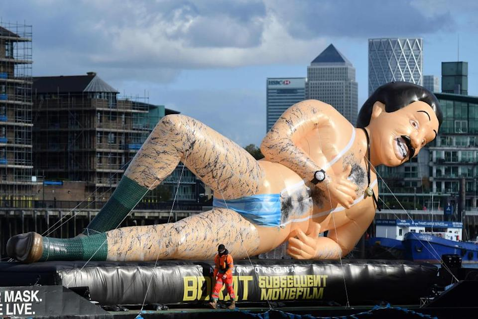 An inflatable Borat floats down the River Thames in London to promote the release of Borat Subsequent Moviefilm.