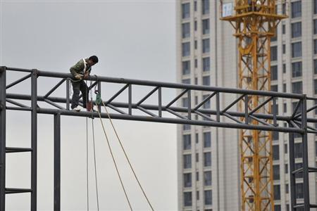 A labourer works at a construction site in Hefei
