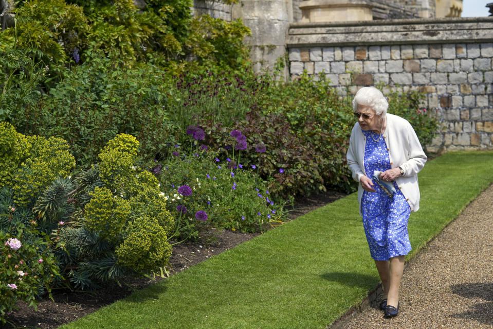 Britain's Queen Elizabeth II views the garden border after receiving a Duke of Edinburgh rose, at Windsor Castle, England, Wednesday June 9, 2021. The newly bred deep pink commemorative rose has officially been named in memory of the late Prince Philip Duke of Edinburgh. A royalty from the sale of each rose will go to The Duke of Edinburgh's Award Living Legacy Fund to support young people taking part in the Duke of Edinburgh Award scheme. (Steve Parsons/Pool via AP)