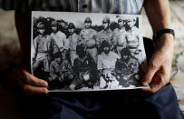 Lee Hak-rae, last surviving Korean war criminal during World War II holds copy of photo in Tokyo