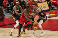 Toronto Raptors forward Pascal Siakam (43) breaks away from New Orleans Pelicans forward Brandon Ingram (14) and guard JJ Redick (4) during the second half of an NBA basketball game Wednesday, Dec. 23, 2020, in Tampa, Fla. (AP Photo/Chris O'Meara)