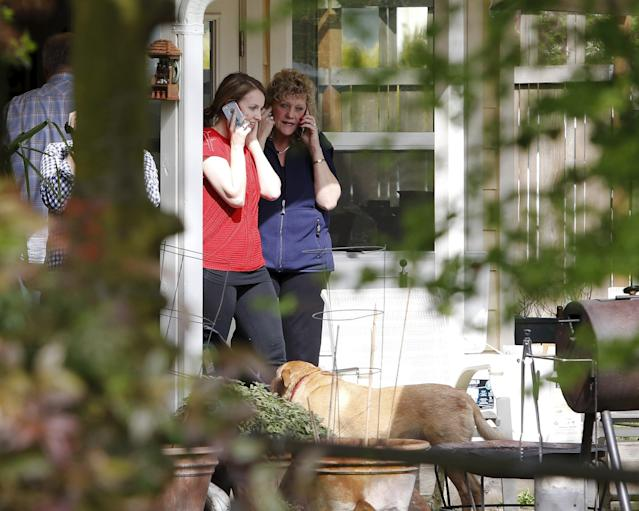 Unidentified people make phone calls after Italy's highest court overturned Amanda Knox's conviction, at the home of Knox's mother in Seattle, Washington March 27, 2015. REUTERS/Jason Redmond