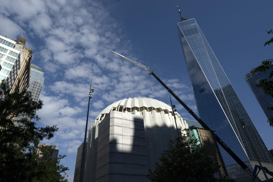 The St. Nicholas Greek Orthodox Church and National Shrine, center, is nearing completion, Wednesday, Sept. 8, 2021, at the World Trade Center in New York. The construction of the only house of worship destroyed in the attacks of September 11, 2001, is now proceeding briskly after years of delays. (AP Photo/Mark Lennihan)