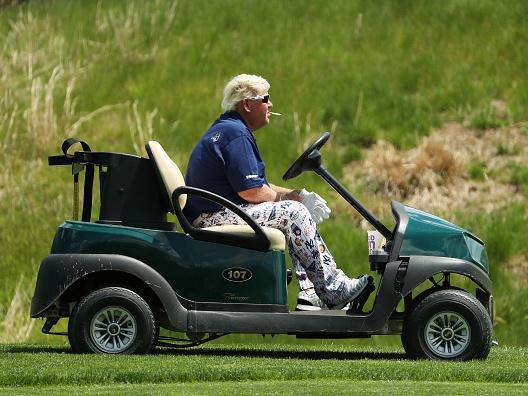 John Daly smokes a Marlboro Red on his route around Bethpage Black (Getty)