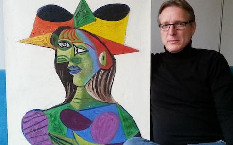 Dutch art detective Arthur Brand posing with stolen Picasso painting Buste de Femme (Dora Maar) on March 14, 2019 at his Amsterdam home - Credit:  AFP/ STRINGER