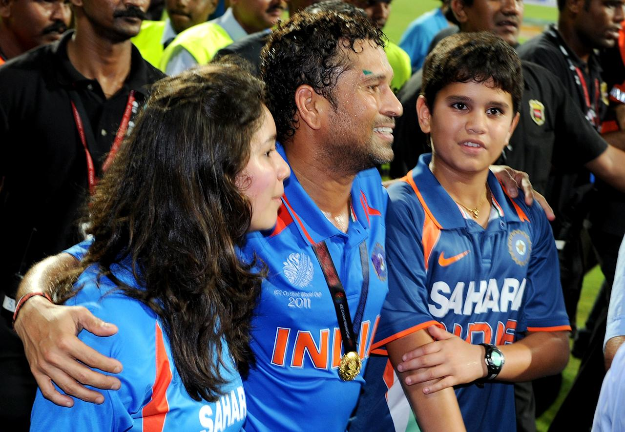 Indian player Sachin Tendulkar (C) walks with his children Ramesh (R) and daughter Sara (L) after India defeated Sri Lanka in the ICC Cricket World Cup 2011 final played at The Wankhede Stadium in Mumbai on April 2, 2011.  India beat Sri Lanka by six wickets.  AFP PHOTO/William WEST (Photo credit should read WILLIAM WEST/AFP/Getty Images)
