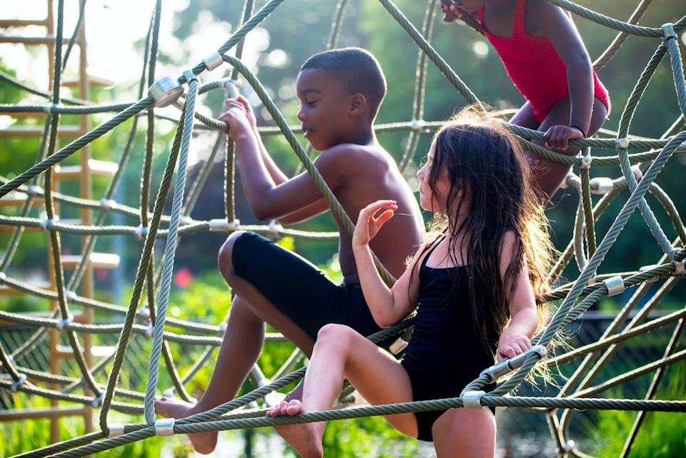 """<span class=""""caption"""">Climbing in the playground is just one of many activities kids can do to improve muscle fitness.</span> <span class=""""attribution""""><a class=""""link rapid-noclick-resp"""" href=""""https://www.gettyimages.com/detail/photo/children-playing-at-the-park-royalty-free-image/1252389648"""" rel=""""nofollow noopener"""" target=""""_blank"""" data-ylk=""""slk:Fran Polito/Moment via Getty Images"""">Fran Polito/Moment via Getty Images</a></span>"""