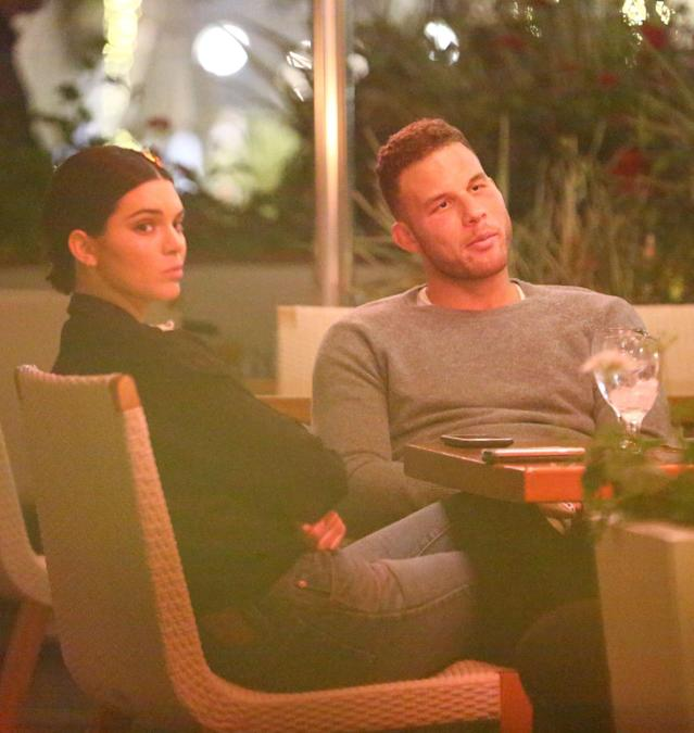 <p>The <em>Keeping Up With the Kardashians</em> star accompanied the pro basketballer and her rumored beau for a dinner with his friends in Beverly Hills. It's not clear whether she was bored or annoyed by the paparazzi. (Photo: Backgrid) </p>