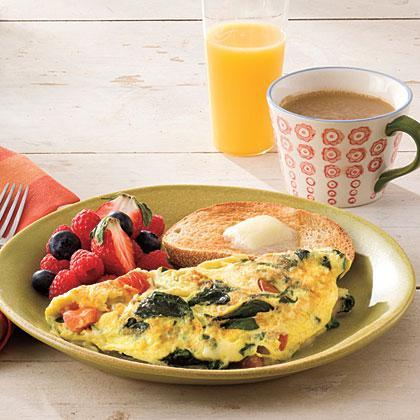 """<p>Add extra nutrients to your breakfast by stirring in chopped <a href=""""https://www.myrecipes.com/ingredients/spinach-recipes"""" rel=""""nofollow noopener"""" target=""""_blank"""" data-ylk=""""slk:fresh spinach"""" class=""""link rapid-noclick-resp"""">fresh spinach</a>, chopped tomato and shredded cheese into your protein-packed omelet. </p>"""