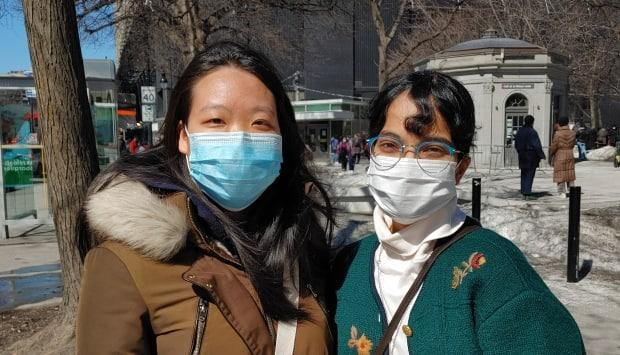 Erica Zhang, left, said she has tried to avoid going out during the pandemic because she fears racist encounters. Zhang attended the march with her friend Imane Karkachi.