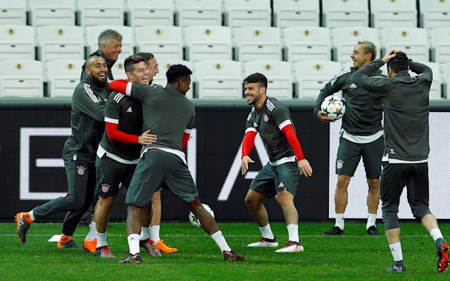 Soccer Football - Champions League - Bayern Munich Training - Vodafone Arena, Istanbul, Turkey - March 13, 2018 Bayern Munich's James Rodriguez, Arturo Vidal and David Alaba during training REUTERS/Murad Sezer