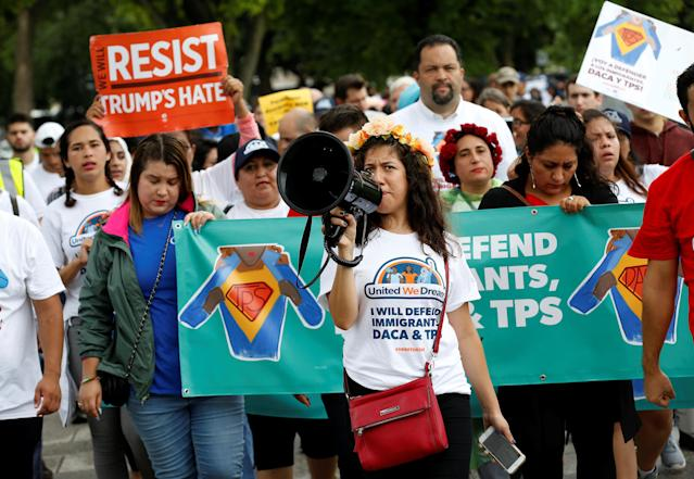 <p>Demonstrators carrying signs march during a rally by immigration activists CASA and United We Dream demanding the Trump administration protect the Deferred Action for Childhood Arrivals (DACA) program and the Temporary Protection Status (TPS) programs, in Washington, D.C., Aug. 15, 2017. (Photo: Joshua Roberts/Reuters) </p>