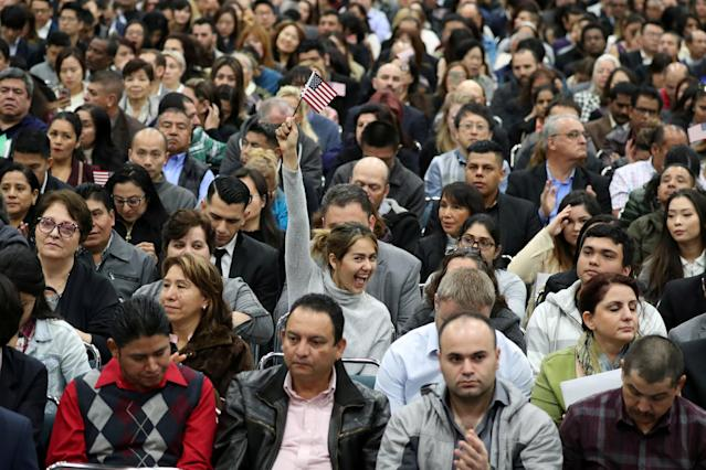 Immigrants participate in a naturalization ceremony to become new U.S. citizens in Los Angeles, California, U.S. March 20, 2018. REUTERS/Lucy Nicholson TPX IMAGES OF THE DAY