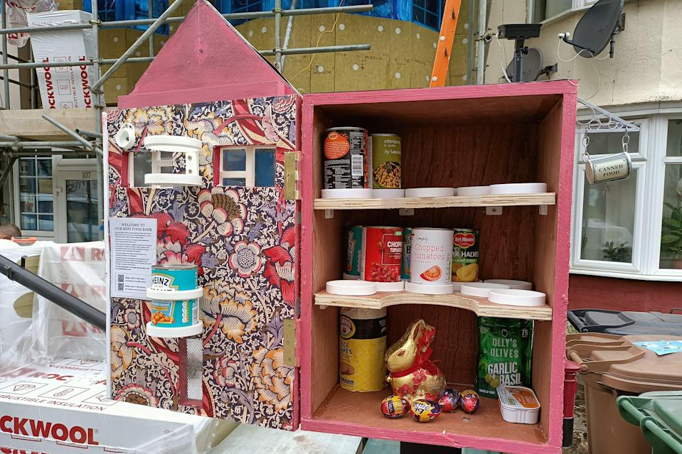 Inside one of the mini food bank drop off points, lined with William Morris wallpaperCaramel Quin