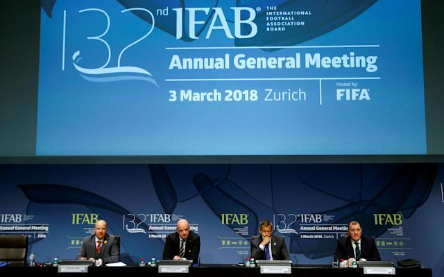 CEO Jonathan Ford of the Football Association of Wales, FIFA President Gianni Infantino, CEO Martin Glenn of the Football Association and CEO Patrick Nelson of the Irish Football Association address a news conference after the 132nd Annual Meeting of the IFAB (International Football Association Board) at FIFA's headquarters in Zurich, Switzerland March 3, 2018. REUTERS/Arnd Wiegmann