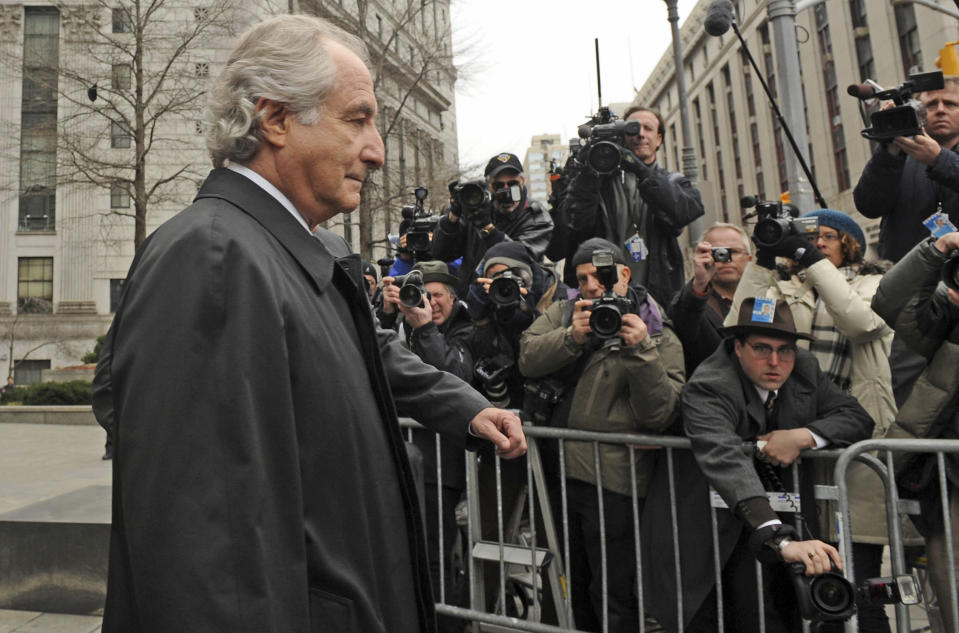 FILE - Bernard Madoff exits Manhattan federal court, Tuesday, March 10, 2009, in New York. The epic Ponzi scheme mastermind is dead. But the effort to untangle his web of deceit lives on. More than 12 years after Madoff confessed to running the biggest financial fraud in Wall Street history, a team of lawyers is still at work on a sprawling effort to recover money for the thousands of victims of his scam.(AP Photo/ Louis Lanzano, File)