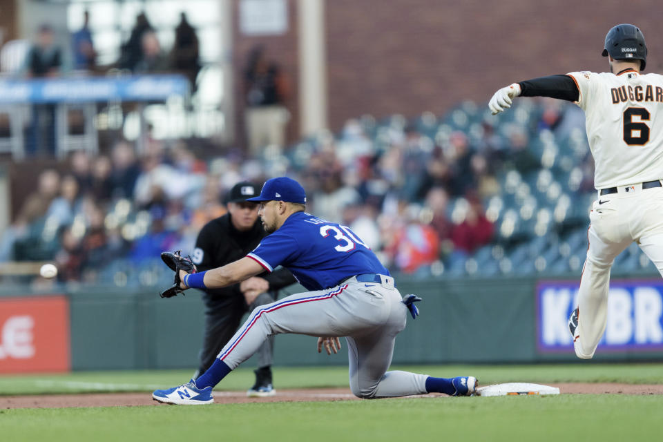 Texas Rangers first baseman Nate Lowe (30) makes the catch for an out against San Francisco Giants' Steven Duggar (6) during the third inning of a baseball game in San Francisco, Monday, May 10, 2021. (AP Photo/John Hefti)