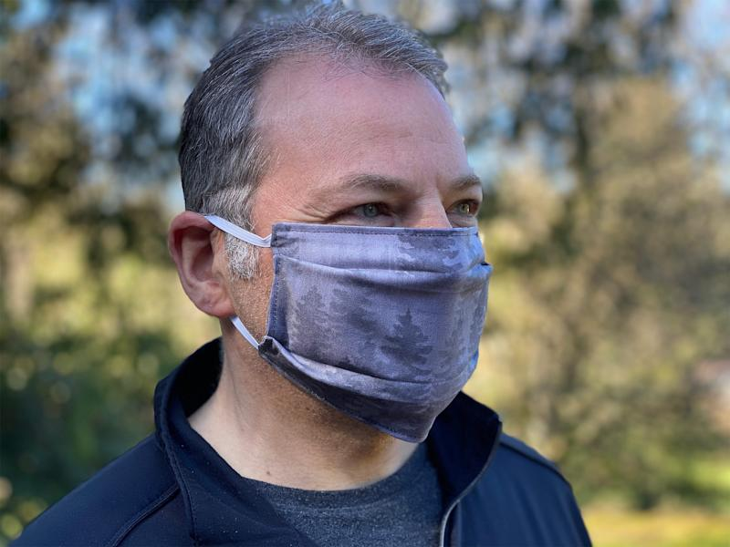 Craig Harris models fabric face masks sewn and given away free by his wife, artist Tara Reed, in Portland, Oregon in March 2020. Reed is among entrepreneurs pivoting as the country confronts the coronavirus pandemic.