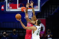 Utah Jazz's Rudy Gobert, right, goes up for a shot against Philadelphia 76ers' Dwight Howard during the first half of an NBA basketball game, Wednesday, March 3, 2021, in Philadelphia. (AP Photo/Matt Slocum)