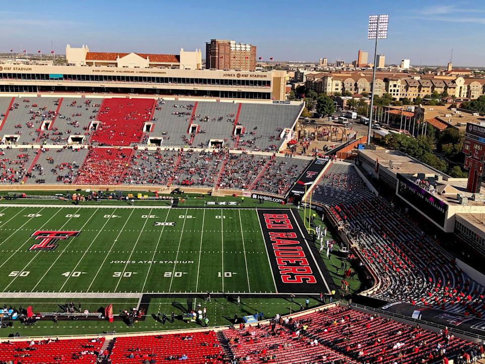 A press-box view of fans scattered throughout the seats of Texas Tech football stadium