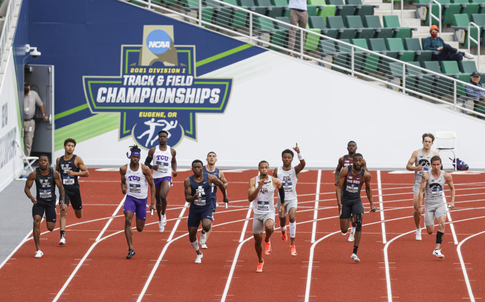 Runners take off on the final leg of the men's 4x100 relay semifinals during theNCAA Division I Outdoor Track and Field Championships, Wednesday, June 9, 2021, at Hayward Field in Eugene, Ore. (AP Photo/Thomas Boyd)