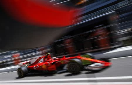 Formula One - F1 - Russian Grand Prix - Sochi, Russia - 28/04/17 - Ferrari Formula One driver Kimi Raikkonen of Finland drives along the pit lane during the first practice session. REUTERS/Maxim Shemetov