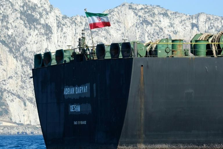 An Iranian flag flutters on board the Adrian Darya oil tanker, formerly known as Grace 1, off the coast of Gibraltar on August 18, before it set sail (AFP Photo/Johnny BUGEJA)