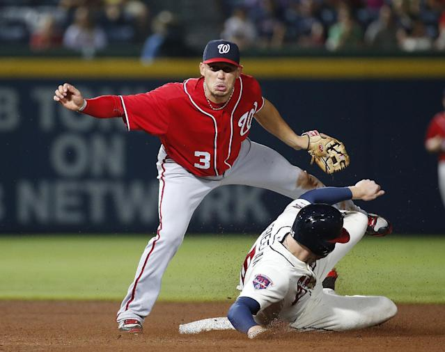 Atlanta Braves' Freddie Freeman is forced out at second base by Washington Nationals second baseman Asdrubal Cabrera (3) on a Justin Upton ground ball in the eighth inning of a baseball game early Sunday, Aug. 10, 2014, in Atlanta. Upton was safe at first. (AP Photo/John Bazemore)