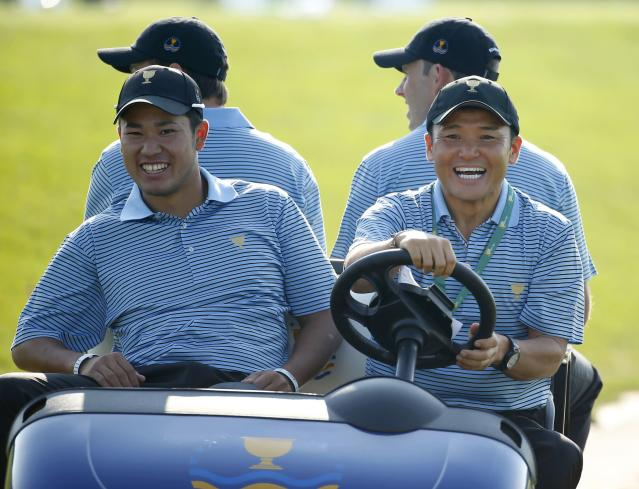 International captain's assistant Shigeki Maruyama, of Japan, drives compatriot Hideki Matsuyama and fellow players in a golf cart during the first practice round for the 2013 Presidents Cup golf tournament at Muirfield Village Golf Club in Dublin, Ohio October 1, 2013. REUTERS/Chris Keane (UNITED STATES - Tags: SPORT GOLF)