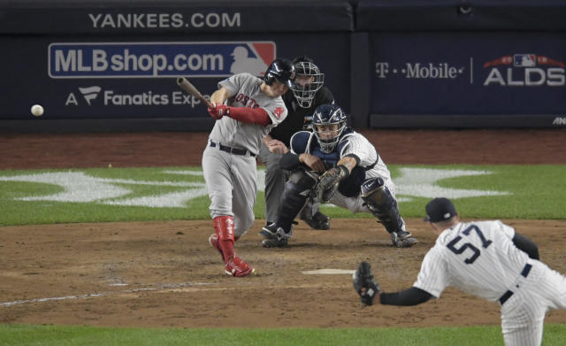 Boston Red Sox's Brock Holt connects for a two-run triple against the New York Yankees during the fourth inning of Game 3 of baseball's American League Division Series, Monday, Oct. 8, 2018, in New York. (AP Photo/Bill Kostroun)