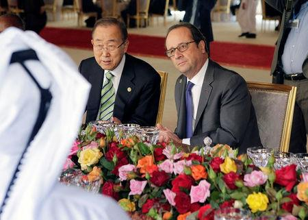 UN Secretary-General Ban Ki-moon speaks with French President Francois Hollande during a lunch at the Royal Palace during the UN Climate Change Conference 2016 in Marrakech