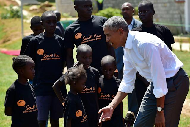 <p>Former US President, Barak Obama (R) interacts with some of the local young beneficiaries July 16, 2018 during the opening of the Sauti Kuu Resource Centre, founded by his half-sister, Auma Obama at Kogelo in Siaya county, western Kenya. – Obama is in the east African nation for the first time since he left the US presidency and met with President Uhuru Kenyatta and opposition leader Raila Odinga in Nairobi. (Photo: Tony Karumba/AFP/Getty Images) </p>