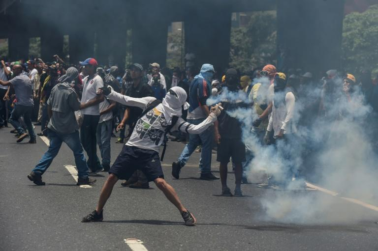 "Marchers in Caracas were forced back by lines of soldiers and police deployed to contain what the opposition vowed would be the ""mother of all protests"""