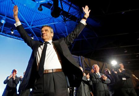 Francois Fillon, former French Prime Minister, member of the Republicans political party and 2017 French presidential election candidate of the French centre-right, salutes supporters during a political rally in Marseille, France, April 11, 2017. REUTERS/Jean-Paul Pelissier