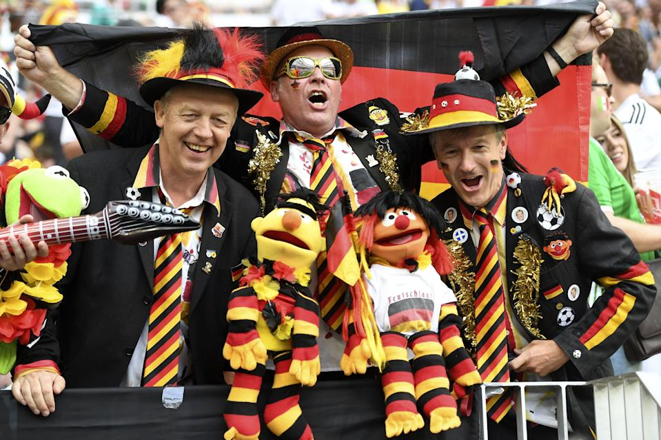 <p>Germany's fans cheer prior to the Russia 2018 World Cup Group F football match between Germany and Mexico at the Luzhniki Stadium in Moscow on June 17, 2018. (Photo by PATRIK STOLLARZ / AFP) </p>