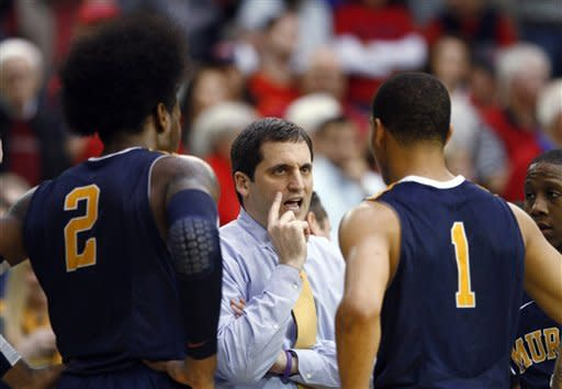 Murray State coach Steve Prohm talks with Ed Daniel (2) and Stacy Wilson (1) during overtime of an NCAA college basketball game against Belmont in the Ohio Valley Conference tournament championship game Saturday, March 9, 2013, in Nashville, Tenn. Belmont won 70-68. (AP Photo/Wade Payne)