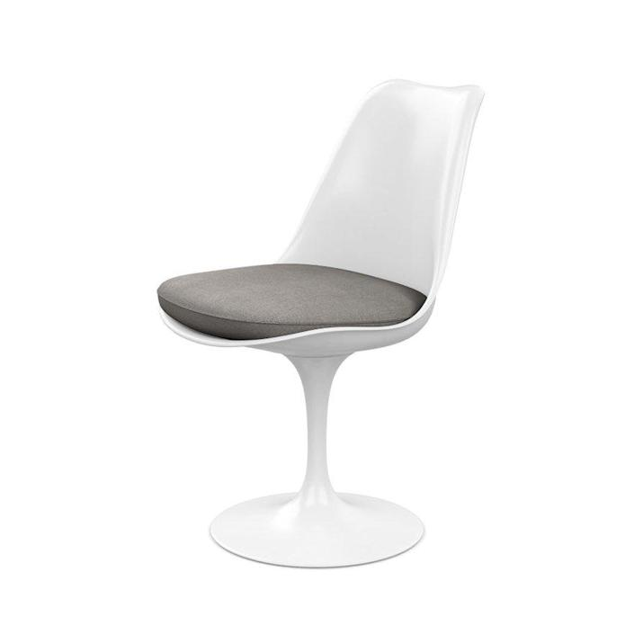 """<p><strong>Eero Saarinen</strong></p><p>knoll.com</p><p><strong>$1648.00</strong></p><p><a href=""""https://go.redirectingat.com?id=74968X1596630&url=https%3A%2F%2Fwww.knoll.com%2Fproduct%2Ftulip-armless-chair&sref=https%3A%2F%2Fwww.redbookmag.com%2Fbeauty%2Fg37132432%2Fchair-types-styles-designs%2F"""" rel=""""nofollow noopener"""" target=""""_blank"""" data-ylk=""""slk:Shop Now"""" class=""""link rapid-noclick-resp"""">Shop Now</a></p><p>Finnish-American architect and designer Eero Saarinen famously hated the sight of many table and chair legs in a room, calling it an """"ugly, confusing, unrestful world."""" In an attempt to streamline these necessary supports, Saarinen developed the Tulip collection, which trades four legs for one central pedestal, supporting a sculptural seat reminiscent of its namesake flower. The chair has been produced by Knoll (the manufacturer founded by Saarinen's friend Florence and her husband Hans Knoll) since 1957. </p>"""