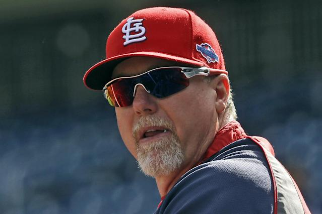 FILE - In this Oct. 10, 2012, file photo, St. Louis Cardinals hitting coach Mark McGwire watches batting practice before Game 3 of the National League division baseball series against the Washington Nationals in Washington. McGwire was hired Wednesday, Nov. 7, as hitting coach for the Los Angeles Dodgers, where he will work with All-Star sluggers Matt Kemp and Andre Ethier. (AP Photo/Pablo Martinez Monsivais, File)