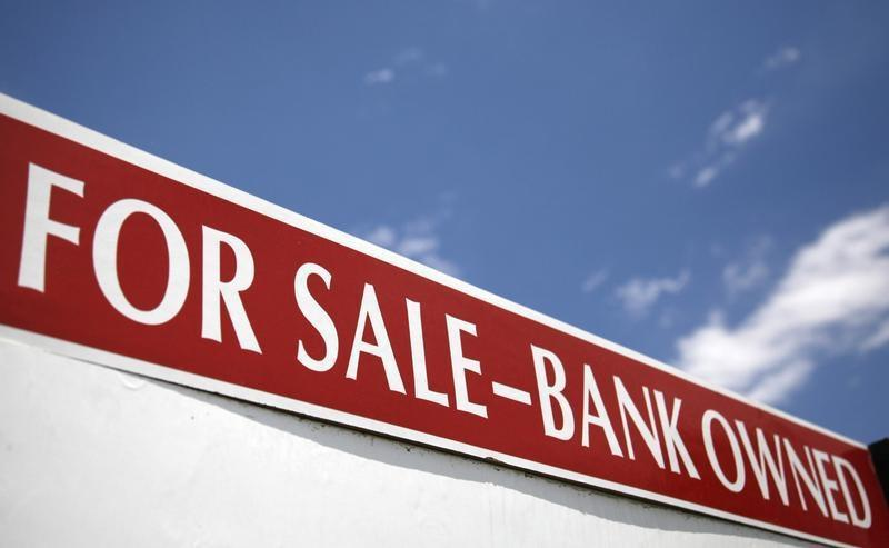 A bank-owned property for sale sign in Arvada