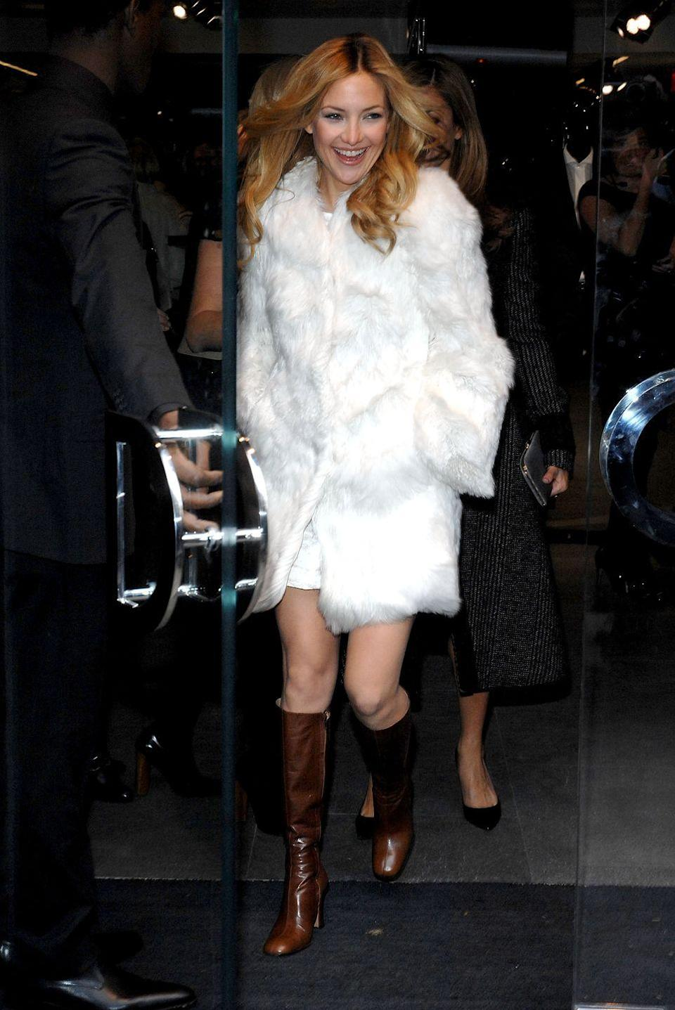 <p>Kate Hudson's luxurious fur jacket and brown leather boots for Dolce & Gabbana's pre-fall collection are reminiscent of something her mom, Goldie Hawn, would have sported in the '60s or '70s.<br></p>