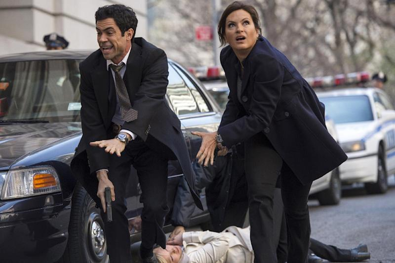 "This publicity photo released by NBC shows, from left, Danny Pino as Detective Nick Amaro, Kelli Giddish as Detective Amanda Rollins, and Mariska Hargitay as Detective Olivia Benson, in ""Poisoned Motive,"" episode 1422, from season 14, in ""Law & Order: Special Victims Unit."" The NBC crime drama returns for its 15th season on Thursday, Sept. 26, 2013. (AP Photo/NBC, Michael Parmelee)"