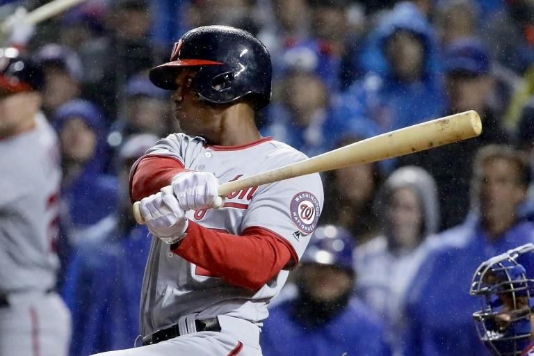 Michael A. Taylor of the Washington Nationals hits a grand slam in the eighth inning during game four of the National League Division Series against the Chicago Cubs, at Wrigley Field in Chicago, Illinois, on October 11, 2017