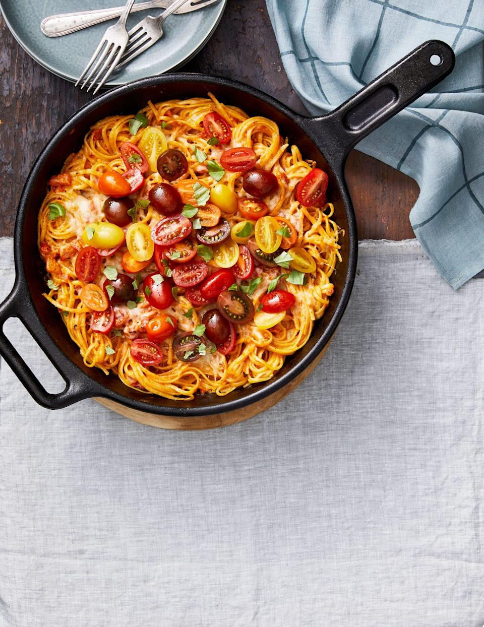 "<p><strong>Recipe: </strong><a href=""https://www.southernliving.com/pasta/baked-linguine-with-spicy-tomato-cream-sauce"" rel=""nofollow noopener"" target=""_blank"" data-ylk=""slk:Baked Linguine with Spicy Tomato-Cream Sauce"" class=""link rapid-noclick-resp""><strong>Baked Linguine with Spicy Tomato-Cream Sauce</strong></a></p> <p>Pasta night just got so much more delicious. This recipe uses fresh refrigerated linguine instead of dried pasta to save you time. Plus, it finishes with a quick broil in the oven to achieve delicious texture.</p>"