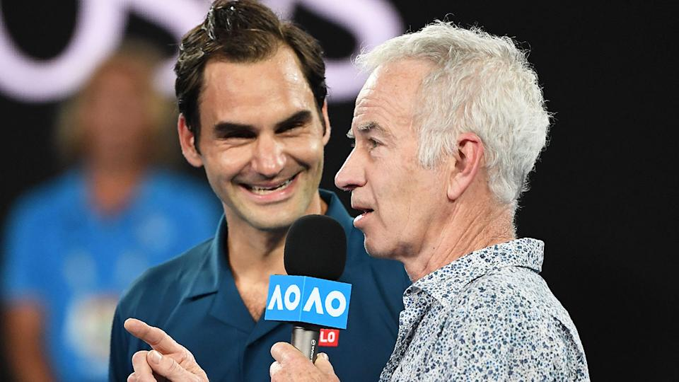 John McEnroe is seen here interviewing Roger Federer at the Australian Open.